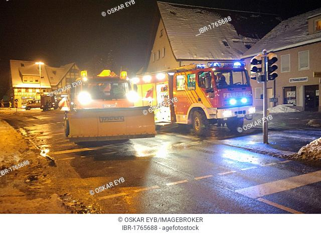 Winter services scattering salt on the road, ice hazard through water used for for firefighting, Kirchheim unter Teck, Baden-Wuerttemberg, Germany, Europe