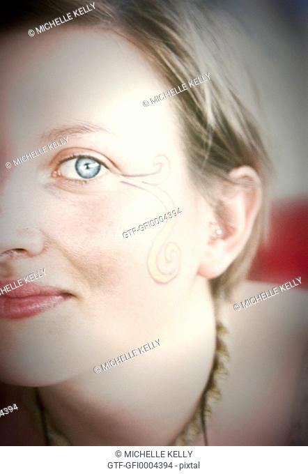 Beautiful Blue Eyed Woman Gazing At Camera