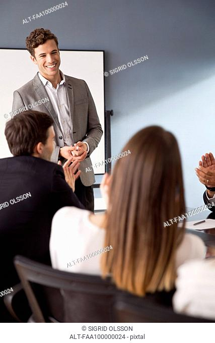 Businessman facilitating group discussion at business meeting