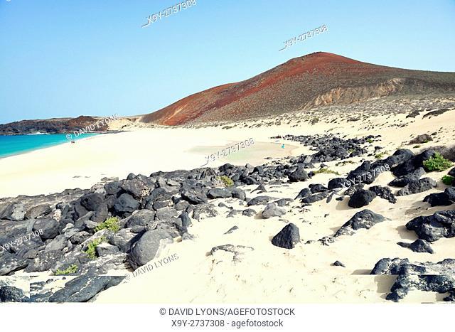 Lanzarote, Canary Islands. Along beach of Playa de las Conchas on Isla Graciosa, Lanzarote, to volcanic cone of Montana Bermeja