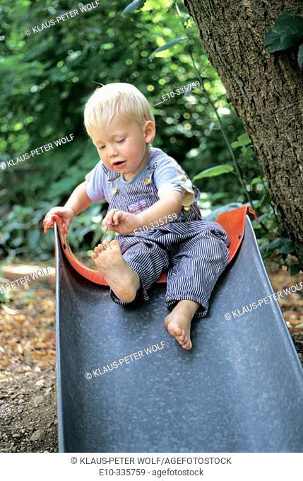2 year old boy on slide