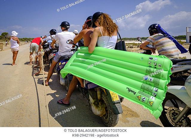 Italian tourists in a motorcycle queue at the entrance of the park, camino de Sa Guia, Parque natural de ses Salines de Ibiza y Formentera, Formentera