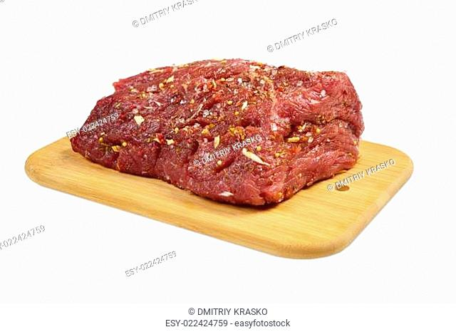Beef with spices on board
