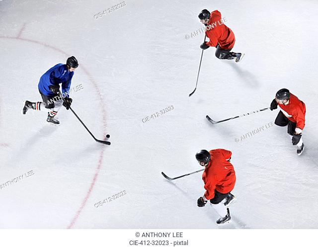 Hockey defenders guarding opponent with puck on ice