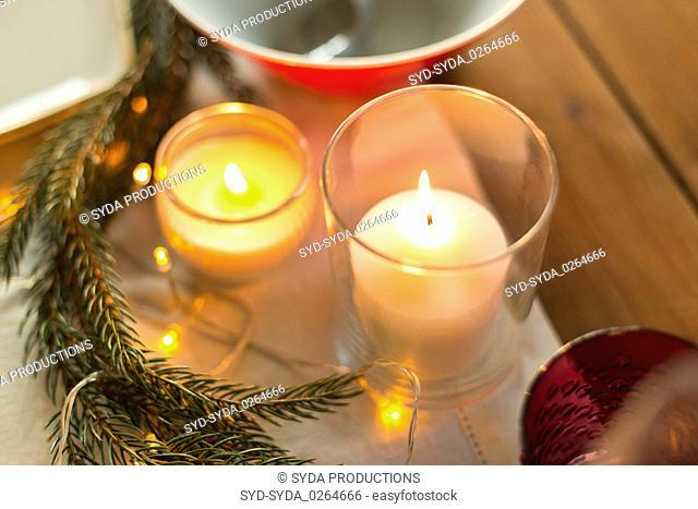 candles burning on christmas table
