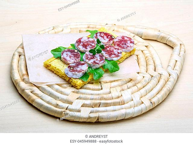 Salami sandwich with dill and salat leaves