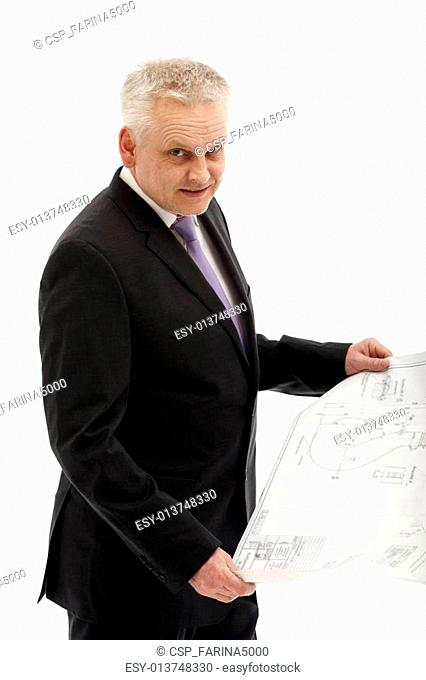 senior businessman in a suit with a plan in his hands