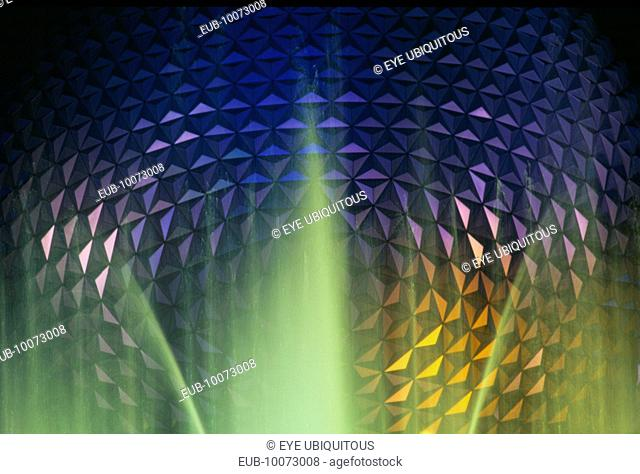 Walt Disney World Epcot Center Spaceship Earth illuminated at night through fountain