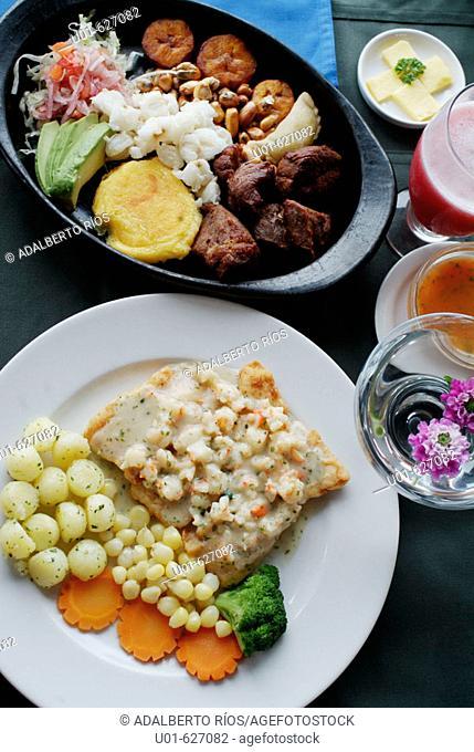 Typical dishes. 'El Crater' restaurant, Pululahua volcano. Ecuador./ Lomo a la plancha estilo ecuatoriano. En el borde del crater del volcan Pululahua cerca de...