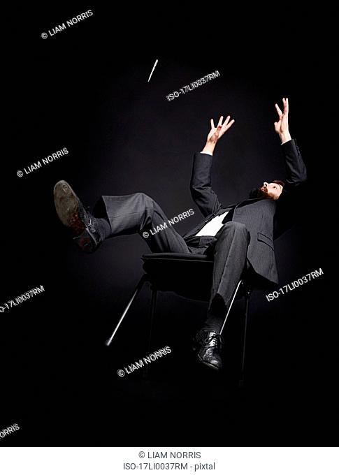 Man falling off a chair