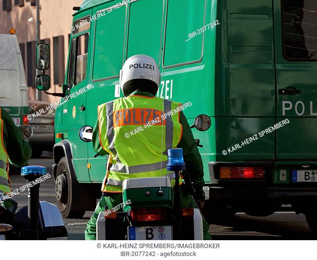Police motorcyclist at a barrier in a road, Regierungsviertel, Government district, Berlin, Germany, Europe