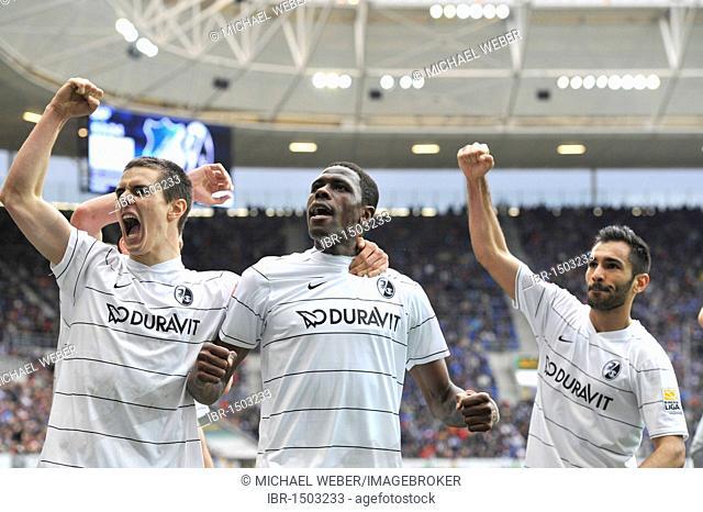 Goal celebrations, Mohamadou Idrissou, center, John Flum, left and Yacine Abdessadki, right, SC Freiburg