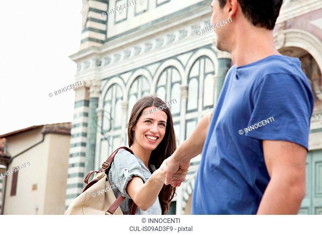 Couple outside Santa Maria Novella church, Florence, Tuscany, Italy