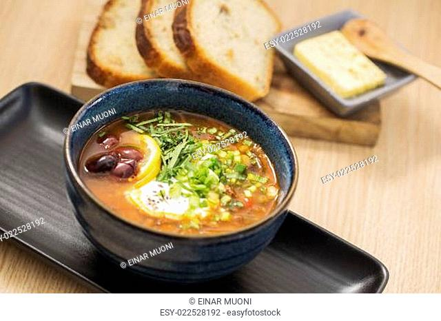 Bowl with delicious soup with sliced bread