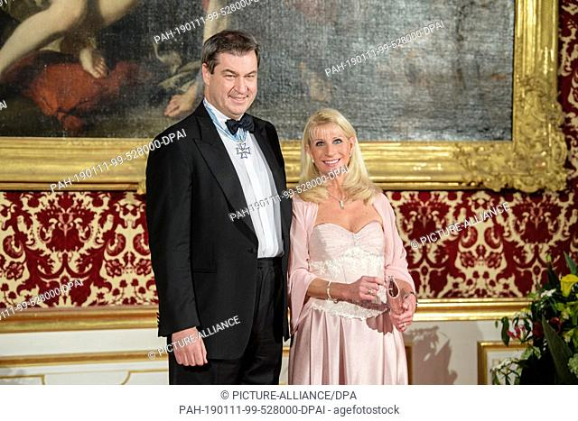 11 January 2019, Bavaria, München: Markus Söder (CSU), Prime Minister of Bavaria, and his wife Karin Baumüller-Söder are waiting for the first guests at the New...