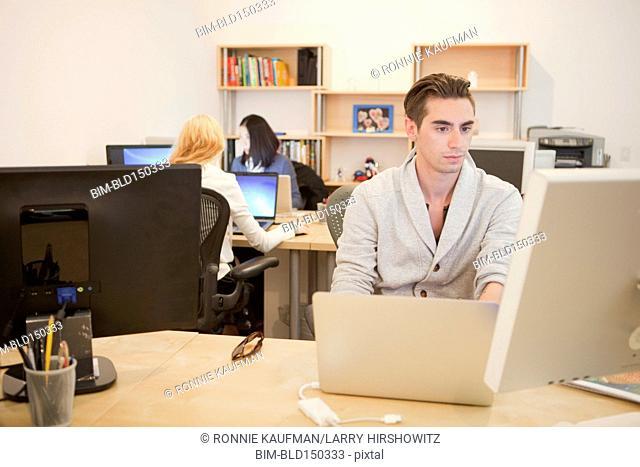 Caucasian businessman working on laptop