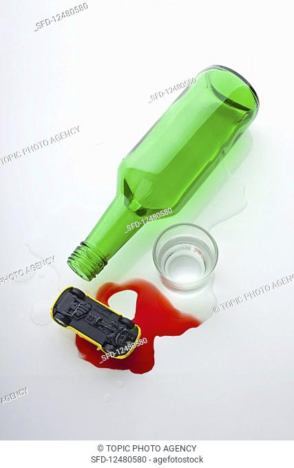 Drink driving warning: empty bottle, spilled soju, and a toy car