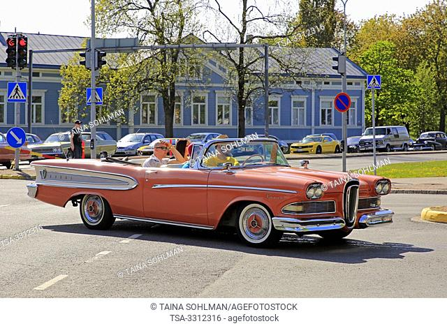 Salo, Finland. May 18, 2019. Orange Edsel Pacer 1958 and other ca 450 vintage cars participating in Salon Maisema Cruising 2019 line up in city traffic