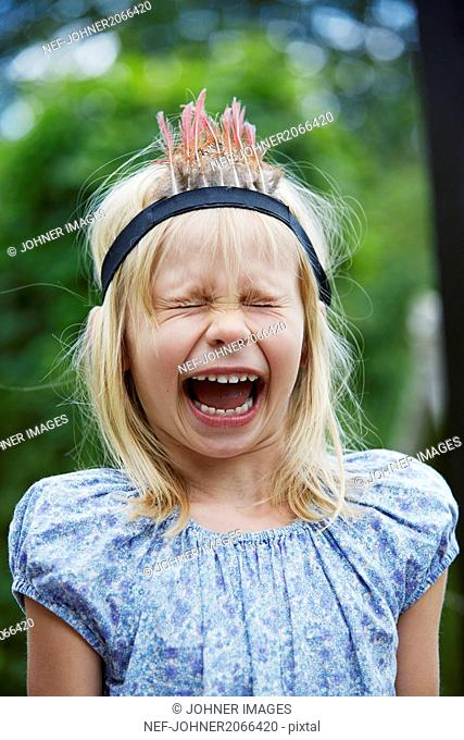 Girl shouting in garden