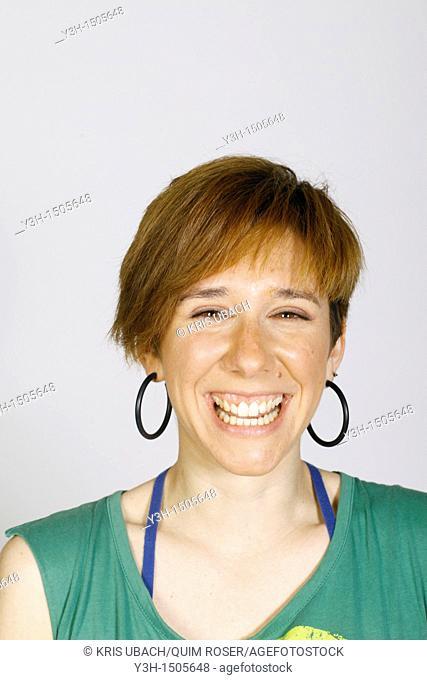 Studio shot of young woman, laughing
