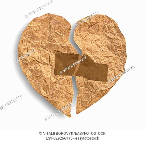 Broken crumpled paper heart coupled with tape isolated on white background