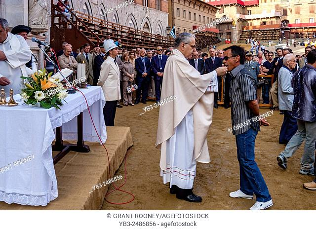 Jockeys Take Part In The Traditional Early Morning Pre Race Mass In The Piazza Del Campo, The Palio di Siena, Tuscany, Italy
