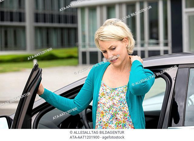 Female car driver has neck pain