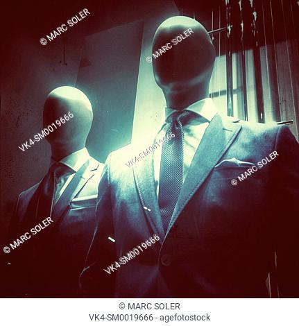 Two mannequins with jacket and tie