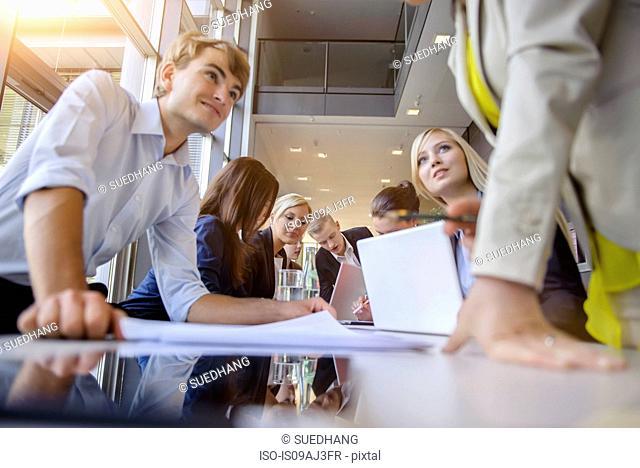 Businessmen and businesswomen at brainstorming meeting