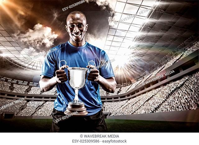 Composite image 3D of portrait of happy athlete holding trophy