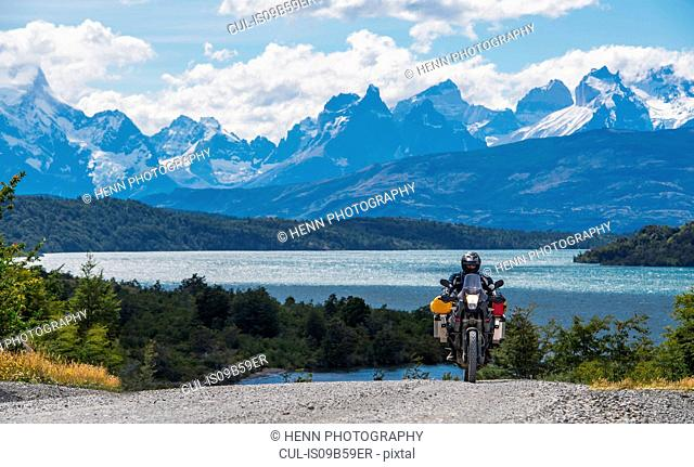 Man riding his touring motorbike at Torres del Paine National Park, Patagonia, Chile