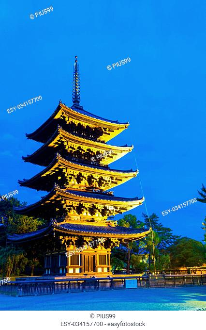 Beautiful blue sky and lighted five story pagoda, goju-no-to, at evening blue hour in Kofuku-ji temple complex in Nara, Japan