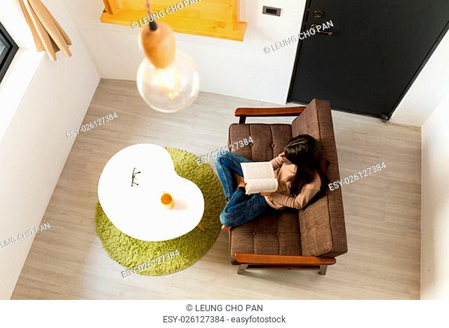 Top view of woman reading book