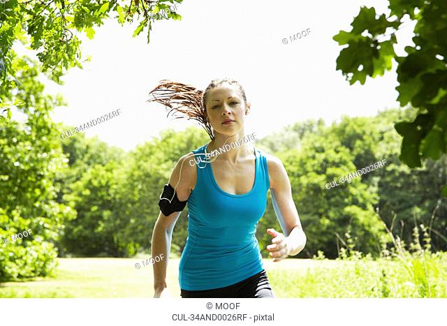 Woman running in forest