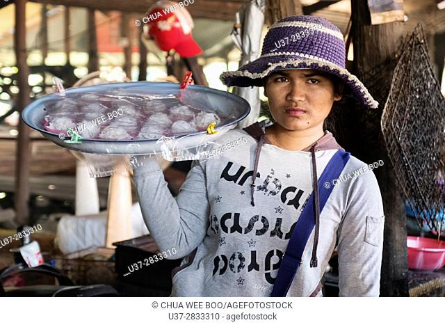 Selling coconut cakes, Siem Reap, Cambodia