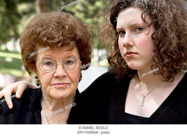 A Grandmother And Granddaughter In A Cemetery; Edmonton, Alberta, Canada