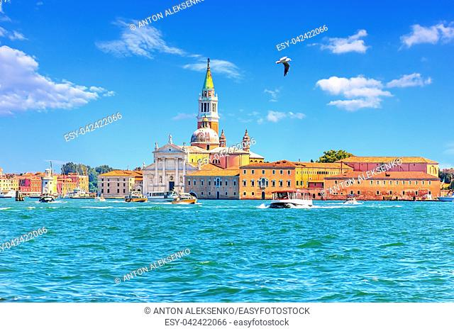 View on Guidecca island with its Church and boats, Venice, Italy