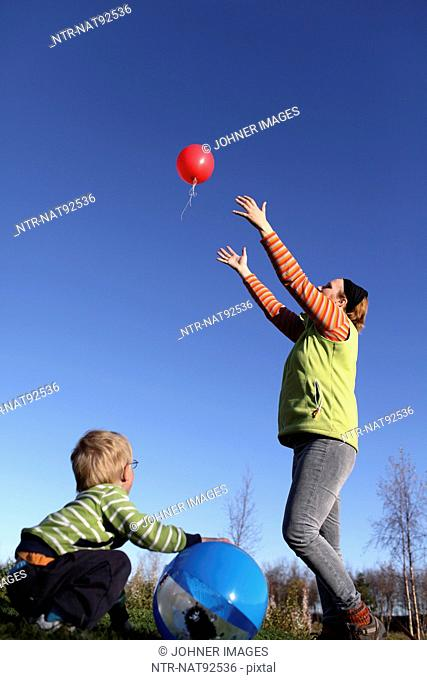 Mother and son playing with balloons