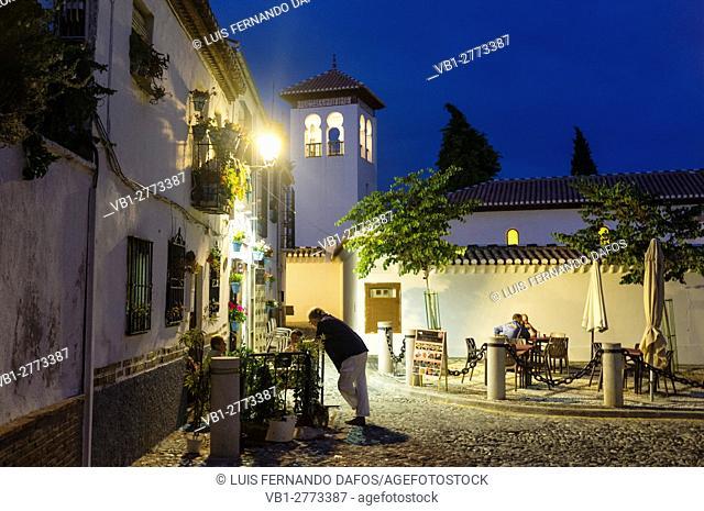 Night street scene with minaret in background at the Unesco listed Albaicin quarter in Granada, Andalusia, Spain
