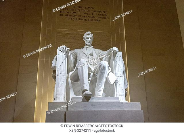 Statue of Abraham Lincoln sitting with pride at Lincoln memorial, Washington, D. C