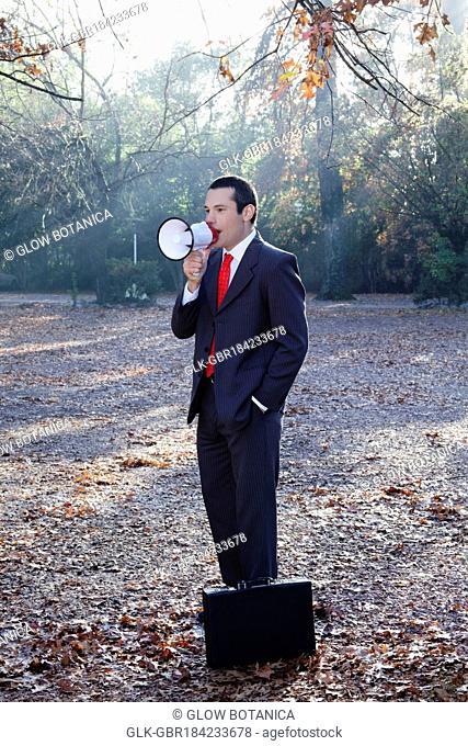Businessman speaking into a megaphone