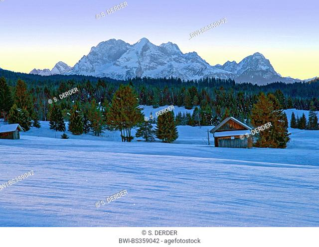 view from Mittenwald to Wetterstein mountain range in winter at sunset, Germany, Bavaria, Oberbayern, Upper Bavaria
