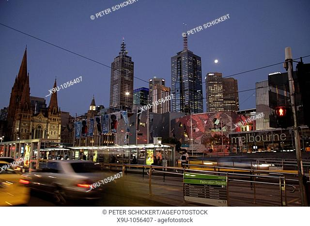traffic at Federation Square and the Melbourne Skyline at night, Victoria, Australia