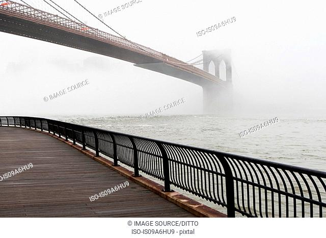 Fog rolling over Brooklyn bridge