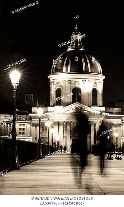 The building of the Institut de France from the Pont des Arts at night. Paris. France
