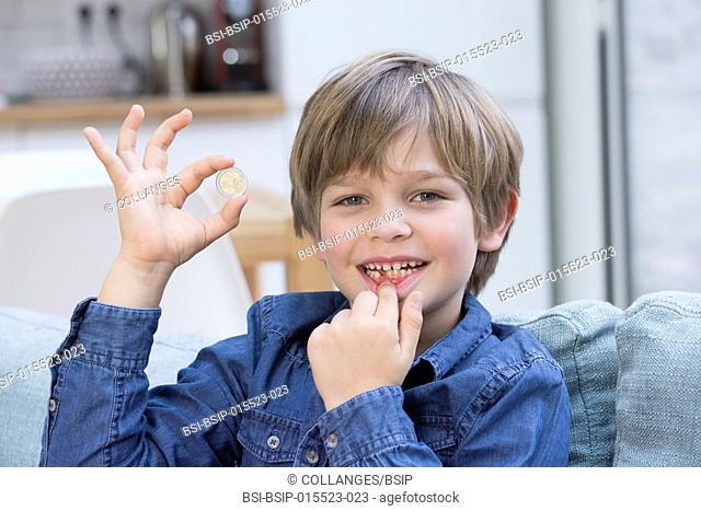 A child who has lost a tooth