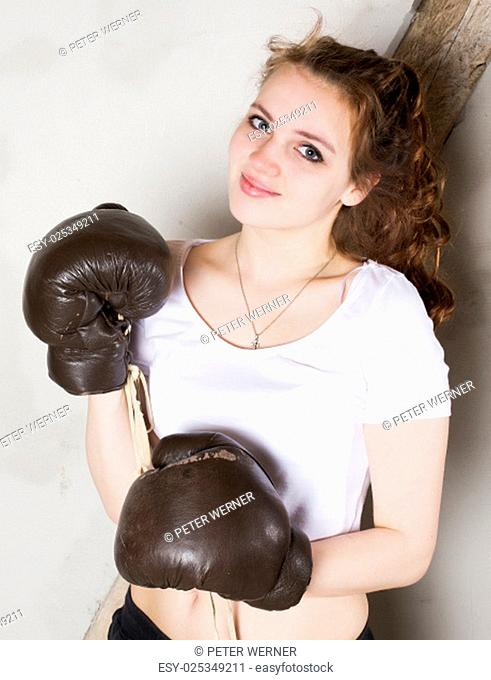 portrait of a girl with brown boxing gloves