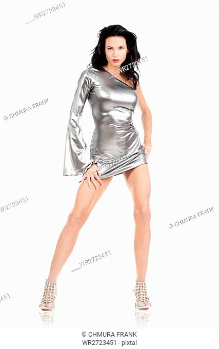 woman with dark hair in silver dress - isolated on white