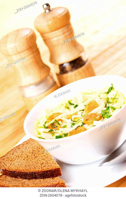 Noodle soup with carrots in the white bowl