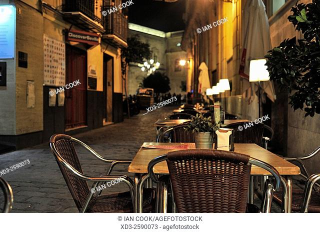 sidewalk cafe at night, Seville, Andalusia, Spain